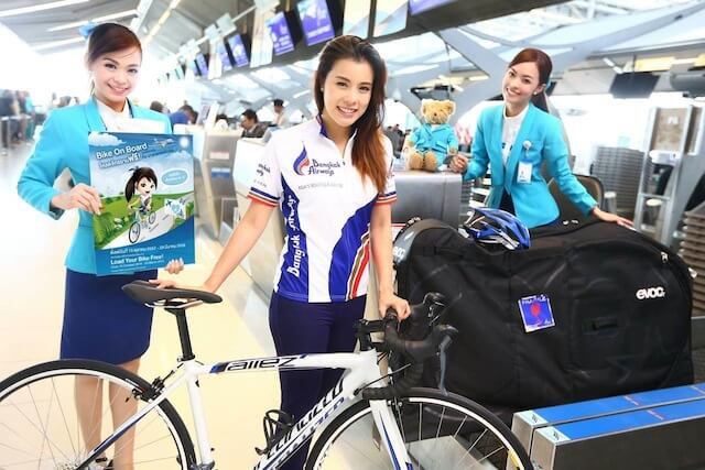 Bangkok Airways counter staff assist Aroonnapa Panichjaroon, actress from Channel 3 and one of Thailand's most renowned celebrity cyclists.