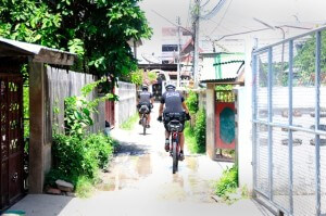 Ayutthaya police on bicycles in small soi