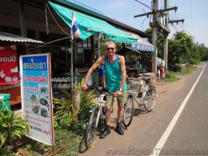 The author at a favourite breakfast stop, Mone's cafe at Ban Ta Tuat