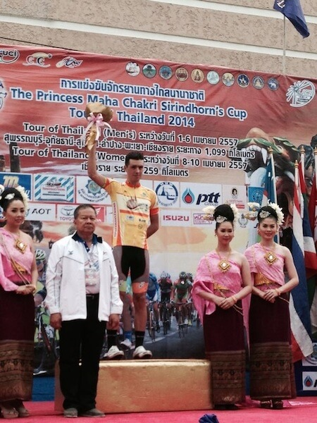 OCBC Singapore Pro Cycling Team rider Eric Sheppard (in yellow jersey) celebrates taking over the yellow jersey after finishing second in Stage 3 of The Princess Maha Chakri Sirindhorn's Cup Tour of Thailand on Thursday in Lampang, Thailand. (Photo credit: OCBC Singapore Pro Cycling Team)
