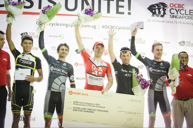 OCBC Singapore Pro Cycling Team rider Cameron Bayly (second from right)celebrates winning the Cycle Asia King of the Sprints title at OCBC Cycle Singapore Professional Criterium on 28 March, at the F1 Pit Building. (Photo Credit: OCBC Singapore Pro Cycling Team)