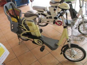 Electric bicycle with child carrier seat