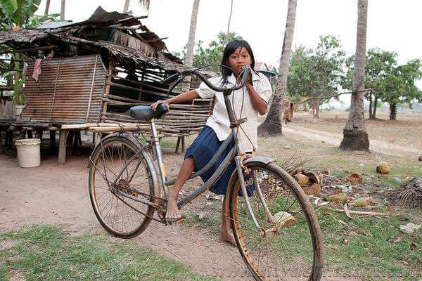 Cambodian Schoolgirl with Bicycle