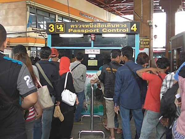 Thailand immigration kiosks. The entry/departure card table where you must pay 2 Ringgit is off to the left of these kiosks.