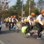 Thailand's 'No One Left Behind' Team: Volunteer cyclists and disabled people riding bicycles together